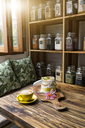 Exotic muesli with flower and coffee cup on a wooden table - SBOF01200