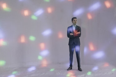 Miniature businessman figurine surrounded by points of light - FLAF00133