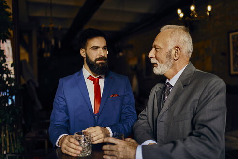 Two elegant men in a bar with tumblers - ZEDF01143