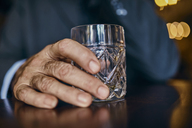 Close-up of man in a bar with tumbler - ZEDF01170