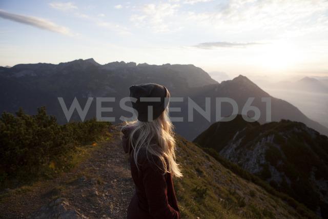 Austria, Tyrol, hiker enjoying the view on Achensee at sunrise - FAF00080