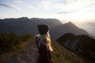 Austria, Tyrol, hiker enjoying the view on Achensee at sunrise - FAF00080