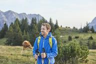 Austria, Tyrol, Mieming Plateau, portrait of smiling hiker on alpine meadow - CVF00053