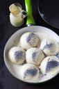 Pan of prepared yeast dumpling in vanilla sauce sprinkled with poppy seed - CSF28756