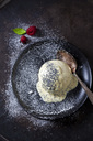 Yeast dumpling with vanilla sauce and poppy seed on plate - CSF28762