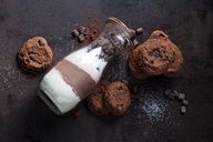 Chocolate cookies and glass bottle of baking mix - CSF28777