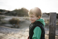 Portrait of a boy grimacing on the beach - JRFF01530
