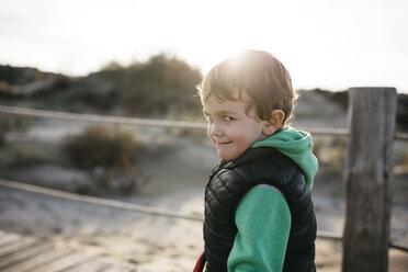 Portrait of a boy grimacing on the beach - JRFF01530