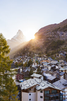 Switzerland, Valais, Zermatt, Matterhorn, townscape, chalets, holiday homes at sunset - WDF04327