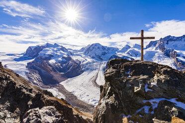 Switzerland, Valais, Zermatt, Monte Rosa, Monte Rosa massif, Monte Rosa Glacier, Border Glacier, Gorner Glacier, View from Gornergrat, summit cross against the sun - WDF04345