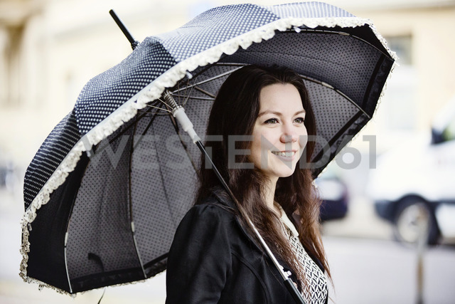 Portrait of fashionable young woman with black vintage umbrella - JATF00995