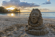 Mauritius, West Coast, Pereybere Beach, lion, sand sculpture at sunset - FOF09777