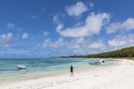 Mauritius, Indian Ocean, Flacq, East Coast, female tourist at beach of Belle Mare - FOF09786