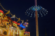 Germany, Bavaria, Munich, View of Oktoberfest fair, Labyrinth and Jule Verne Tower at night - SIEF07676