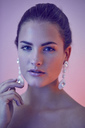 Portrait of lascivious young woman wearing earings - PNEF00386