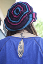 Rear view of young woman with dreadlocks wearing wooly hat - LFEF00025