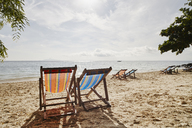 Thailand, Phi Phi Islands, Ko Phi Phi, deckchairs on the beach - RORF01075