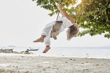 Thailand, Phi Phi Islands, Ko Phi Phi, little girl on a rope swing on the beach - RORF01102
