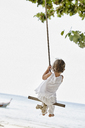 Thailand, Phi Phi Islands, Ko Phi Phi, little girl on a rope swing on the beach - RORF01108