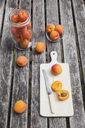 Apricots on garden table - GWF05403