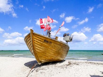 Germany, Mecklenburg-Western Pomerania, Baltic sea seaside resort Binz, fishing boat at beach - PUF01186
