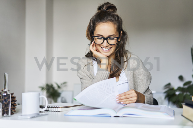 Happy female student learning at home - BSZF00174