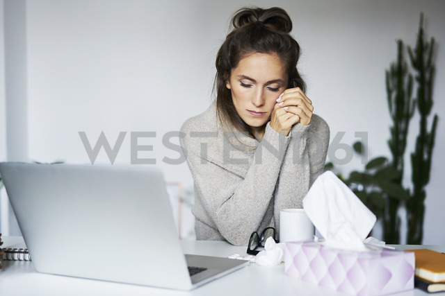 Ill woman working at home at desk - BSZF00183