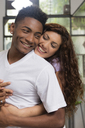 Happy young woman in love hugging her boyfriend - LFEF00043