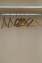 Empty coat hangers in a closet - MELF00193