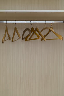 Empty coat hangers in a closet - MELF00193