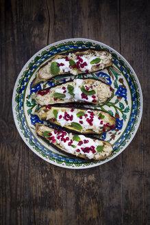 Filled aubergine, couscous, yogurt sauce, mint and pomegranate seeds - LVF06649