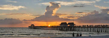 USA, Florida, Naples, panoramic view of Naples Pier with crowd enjoying sunset - SHF02000