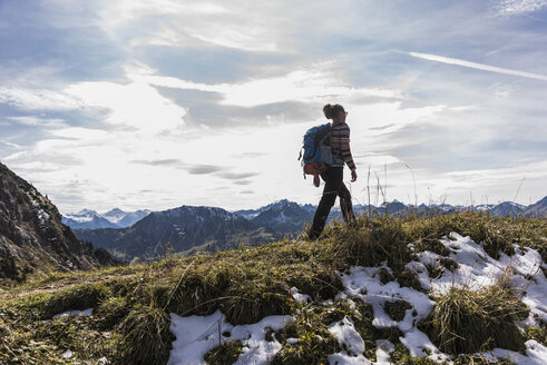 Austria, Tyrol, young woman hiking in the mountains - UUF12539