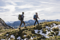 Austria, Tyrol, young couple hiking in the mountains - UUF12542