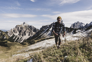Austria, Tyrol, young man hiking in the mountains - UUF12548