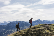 Austria, Tyrol, young couple hiking in the mountains - UUF12557