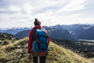 Austria, Tyrol, young woman hiking in the mountains - UUF12560