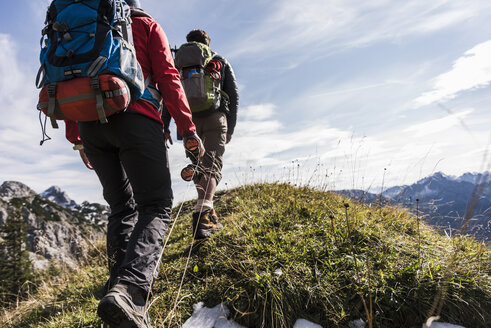 Austria, Tyrol, young couple hiking in the mountains - UUF12578