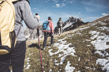 Austria, Tyrol, three hikers walking in the mountains - UUF12584