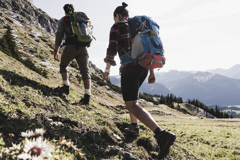 Austria, Tyrol, young couple hiking in the mountains - UUF12590