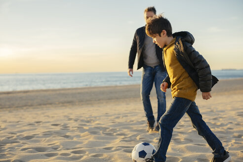 Father and son playing football on the beach - EBSF02040