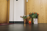 Farewell flowers, candle and condolende card at apartment door of deceased neighbour - MFF04380