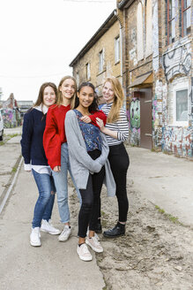 Germany, Berlin, group picture of four happy girlfriends - OJF00234