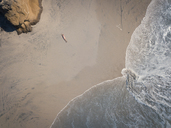Aerial view at a beach section of Riviera Nayarit, Mexico, with a woman lying on her back tanning. - ABAF02197