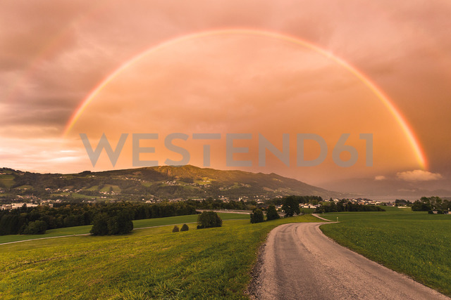 Austria, Upper Austria, Gaisberg, landscape with rainbow and red sky - WVF00917