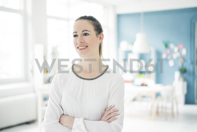 Portrait of smiling young woman in a loft - MOEF00718