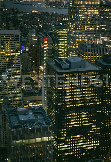 USA, New York, Manhattan, high-rise buildings at night - DAPF00881