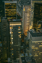 USA, New York, Manhattan, high-rise buildings at night - DAPF00884