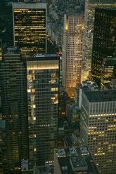 USA, New York, Manhattan, high-rise buildings at night - DAPF00884