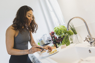Woman preparing healthy food in kitchen - ASCF00812